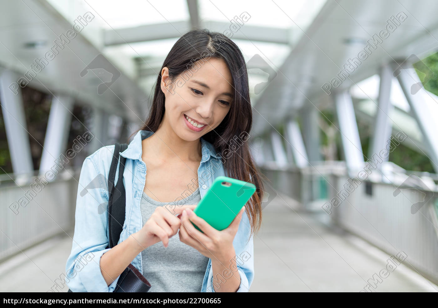 asian, woman, working, on, mobile, phone - 22700665