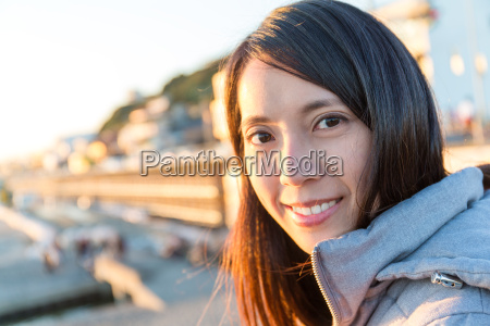 woman, going, seaside, under, sunset - 22700449