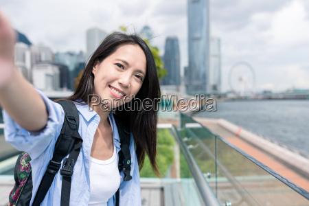 woman, holding, camera, to, take, selfie - 22700559