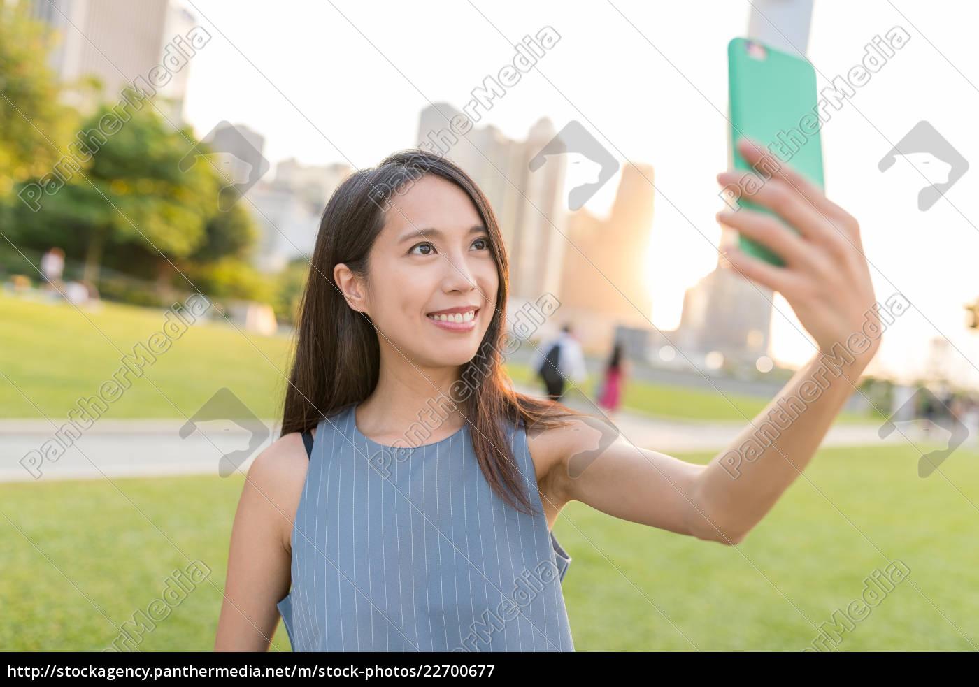 woman, taking, photo, herself, in, hong - 22700677