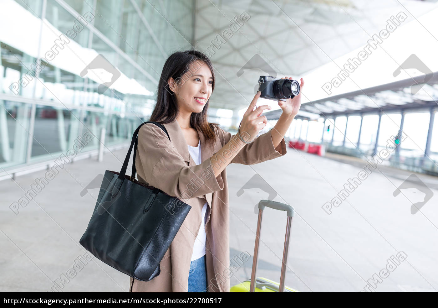 woman, taking, photo, with, digital, camera - 22700517