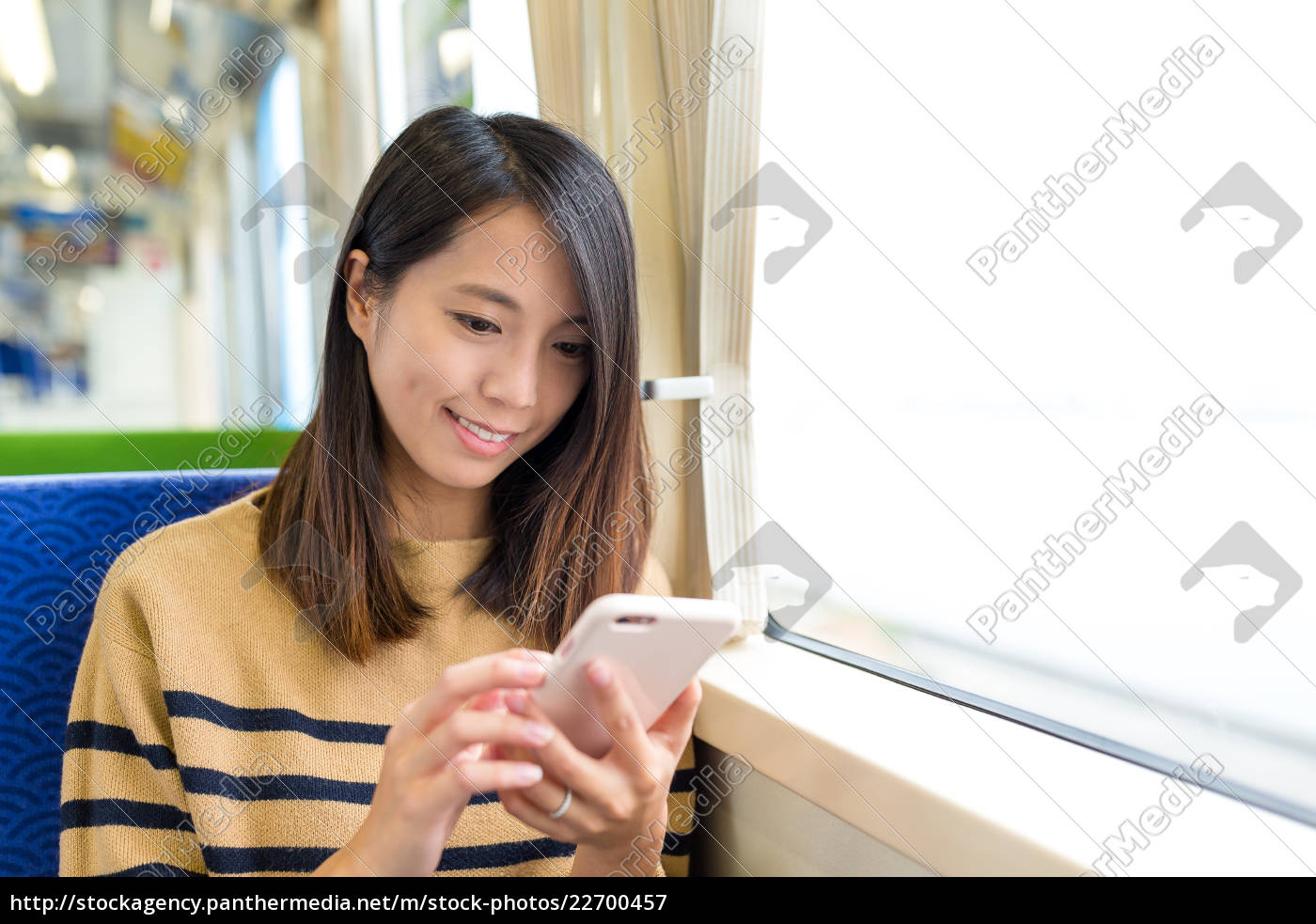 woman, use, of, mobile, phone, on - 22700457