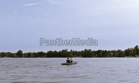 young woman in paddle boat