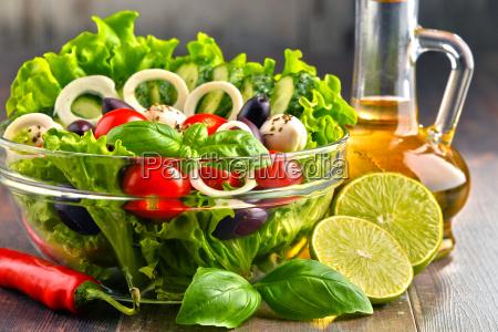 composition with vegetable salad bowl balanced