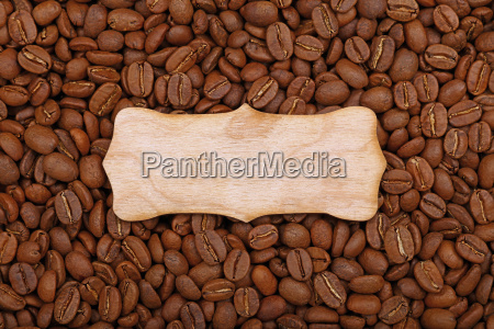wooden sign over roasted coffee beans