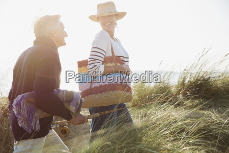 smiling mature couple with fishing rod