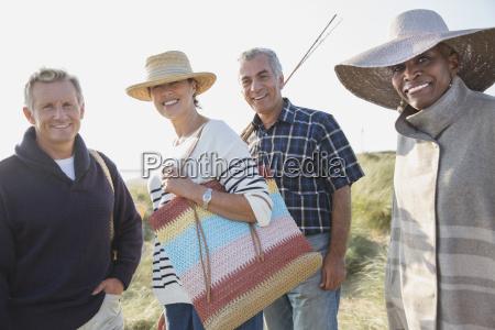 portrait smiling mature couples on sunny