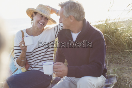 mature couple drinking coffee in sunny