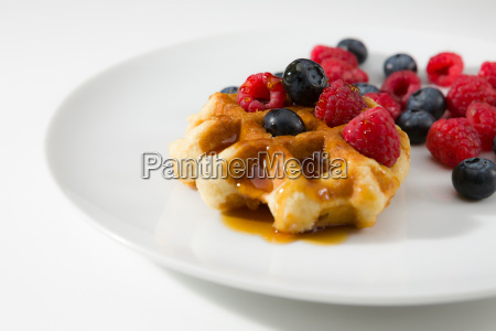 waffles with fresh ripe berries