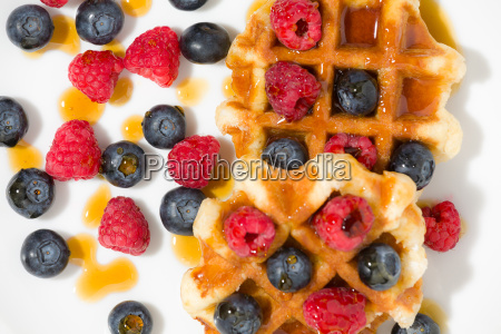 close up of waffles with berries