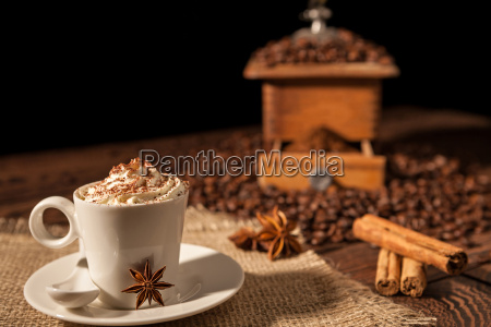 coffee cup with whipped cream cocoa