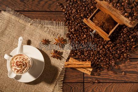 coffee cup star anise cinnamon sticks