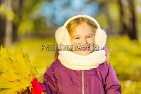 happy, little, girl, in, earflaps, with - 22719035