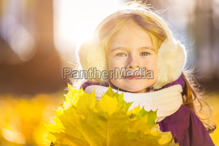 happy, little, girl, in, earflaps, with - 22719037