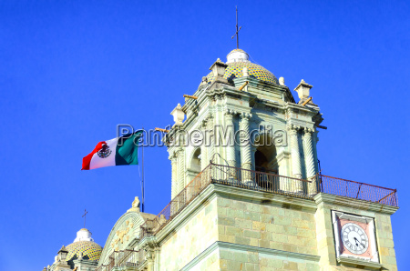 church tower with flag in oaxaca