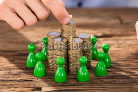 businessman, placing, coins, over, stack, with - 22721227