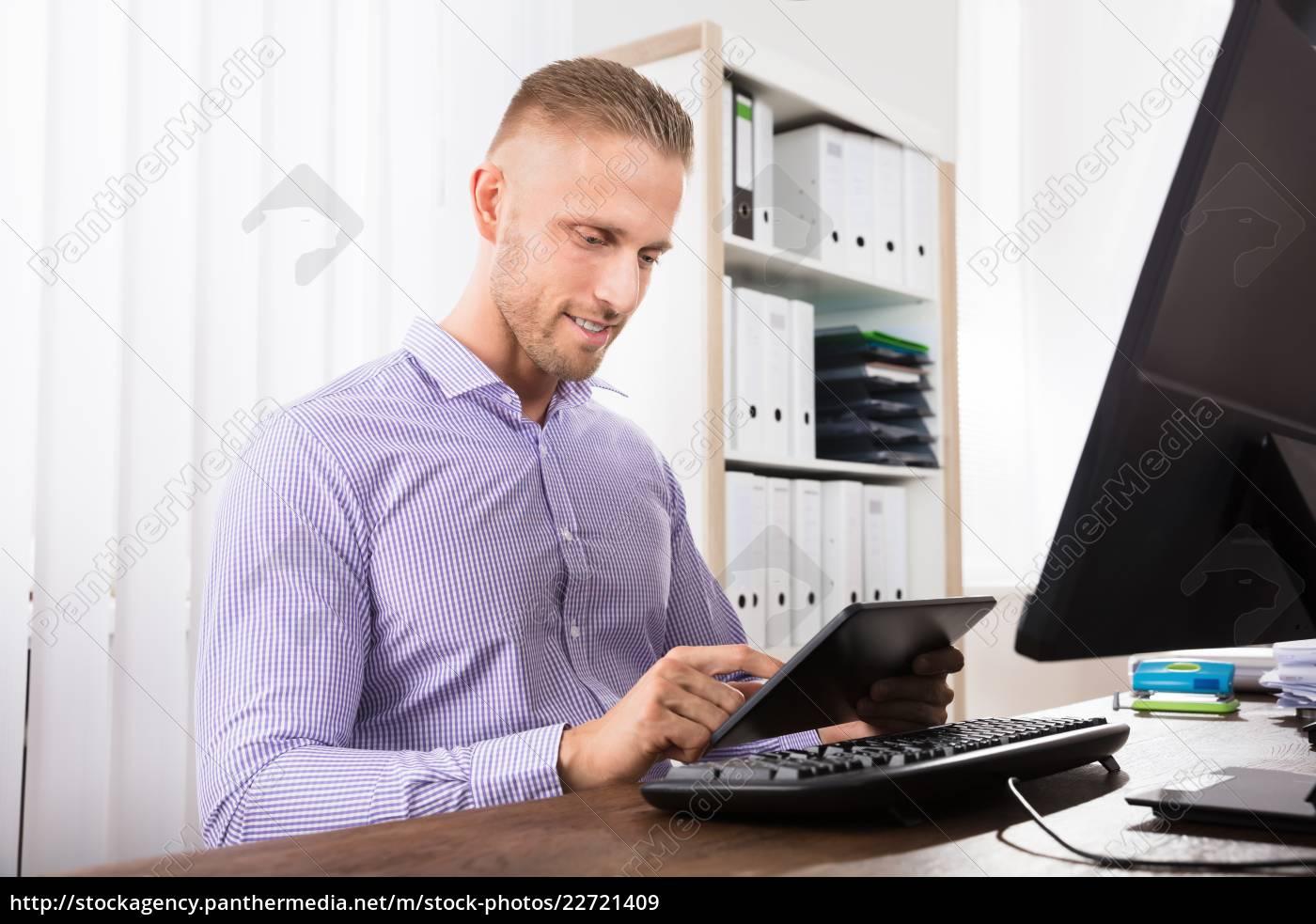 businessman, using, digital, tablet, in, office - 22721409