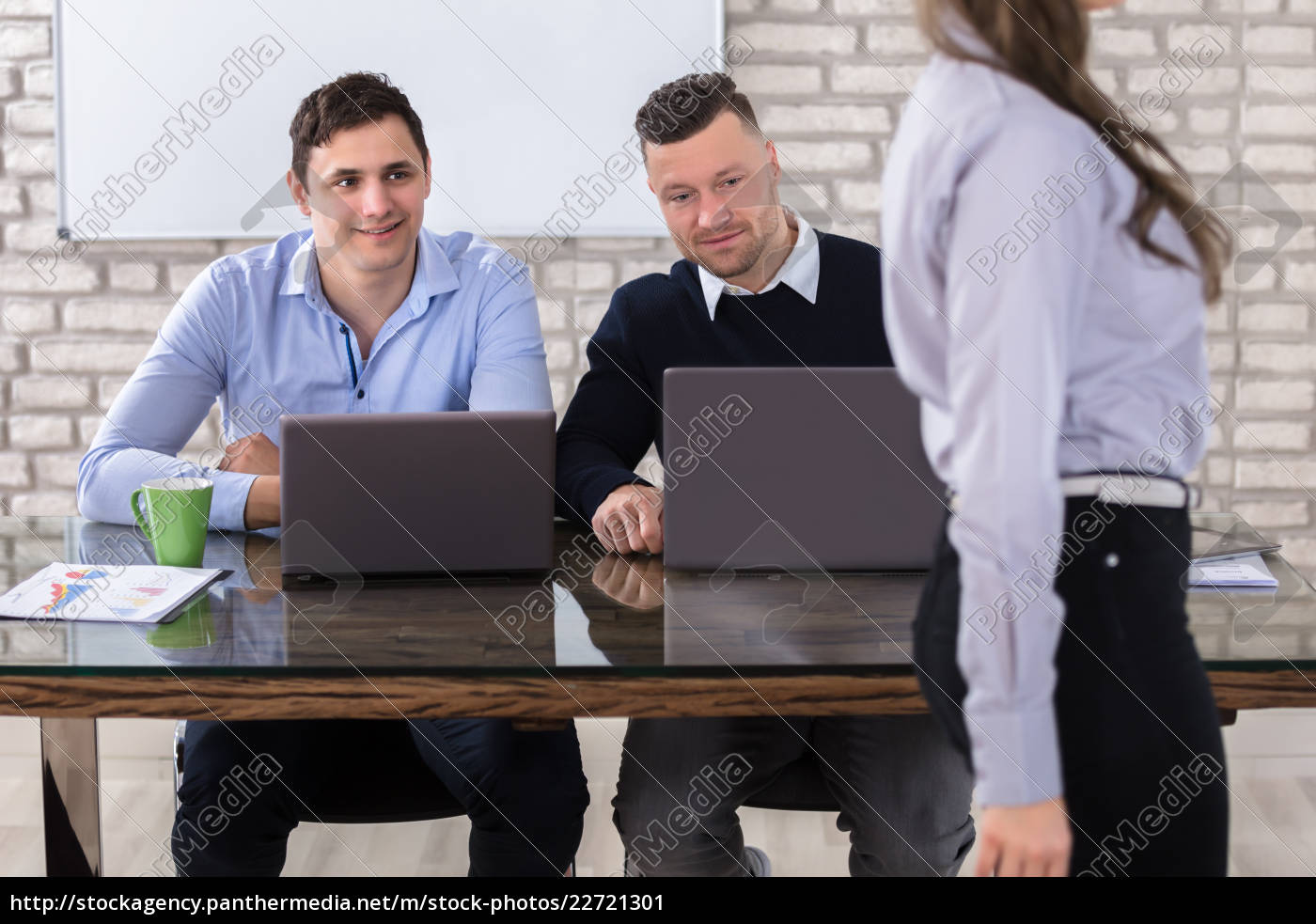 businessmen, looking, at, woman - 22721301