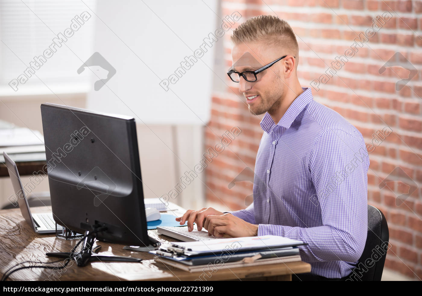 confident, businessman, working, on, computer - 22721399