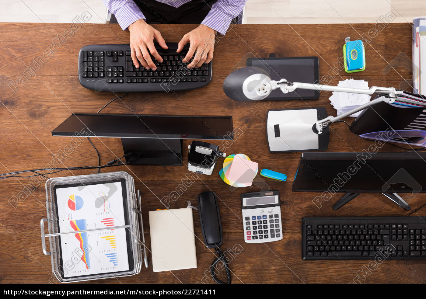 elevated, view, of, businessperson, working, on - 22721411