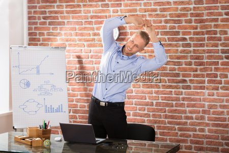 man, exercising, in, office - 22721263