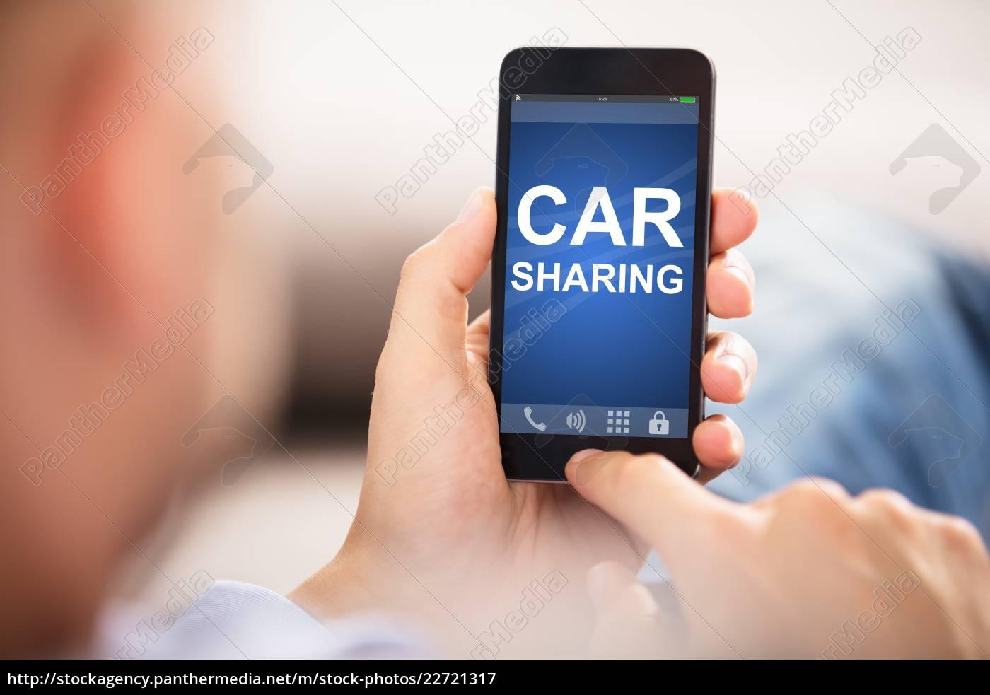 man, using, car, sharing, application, on - 22721317