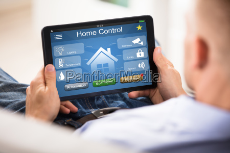 man, using, home, control, system, on - 22721351
