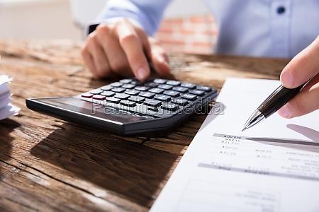 person, calculating, finance, using, calculator - 22721243