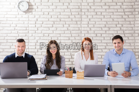 portrait, of, a, businesspeople, at, workplace - 22721211