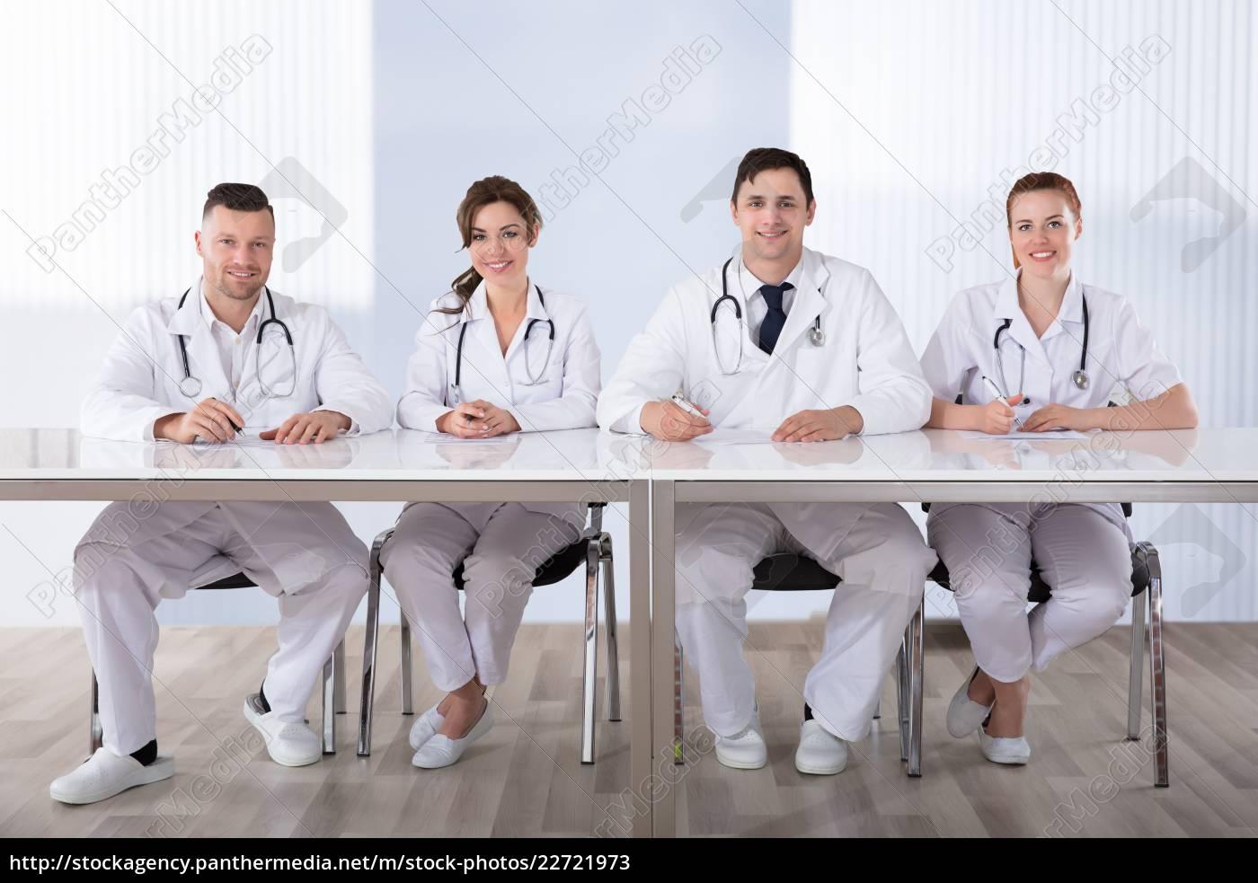smiling, professional, doctors, at, desk - 22721973