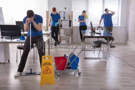 tired, janitors, in, the, office - 22721965