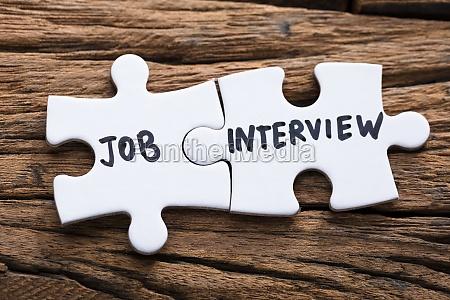 closeup of connected job interview jigsaw