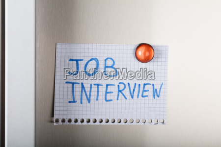 job interview note attached with orange