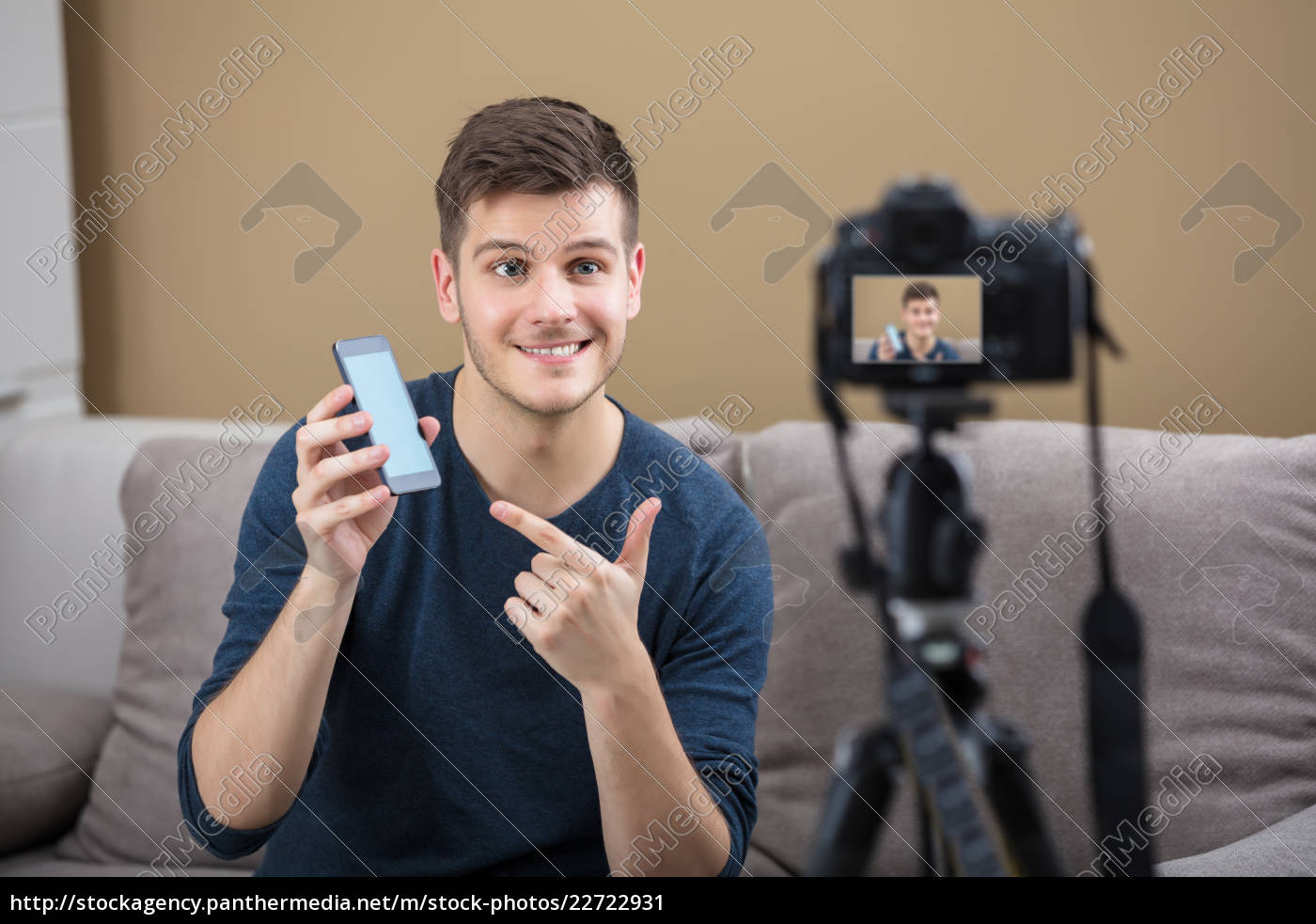 blogger, holding, mobile, phone, recording, video - 22722931