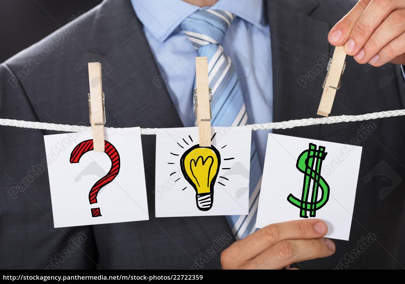 businessman, pinning, dollar, sign, card, on - 22722359