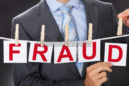 businessman, pinning, fraud, cards, on, clothesline - 22722369