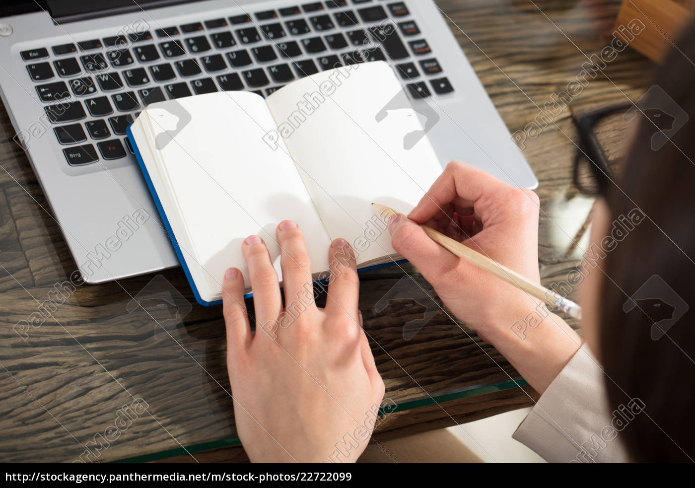 businessperson, writing, on, plain, notebook, with - 22722099
