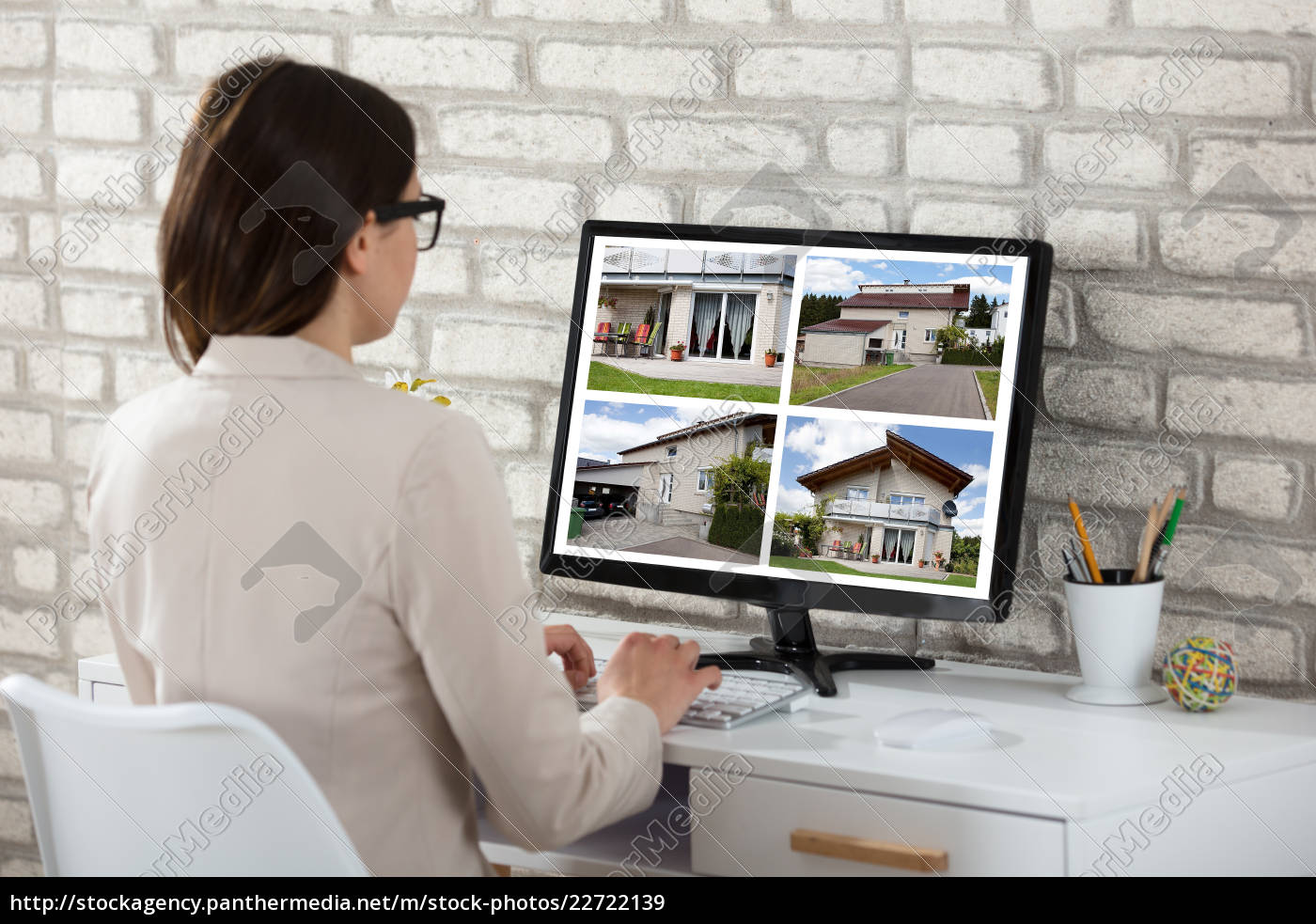 businesswoman, looking, at, house, photos - 22722139