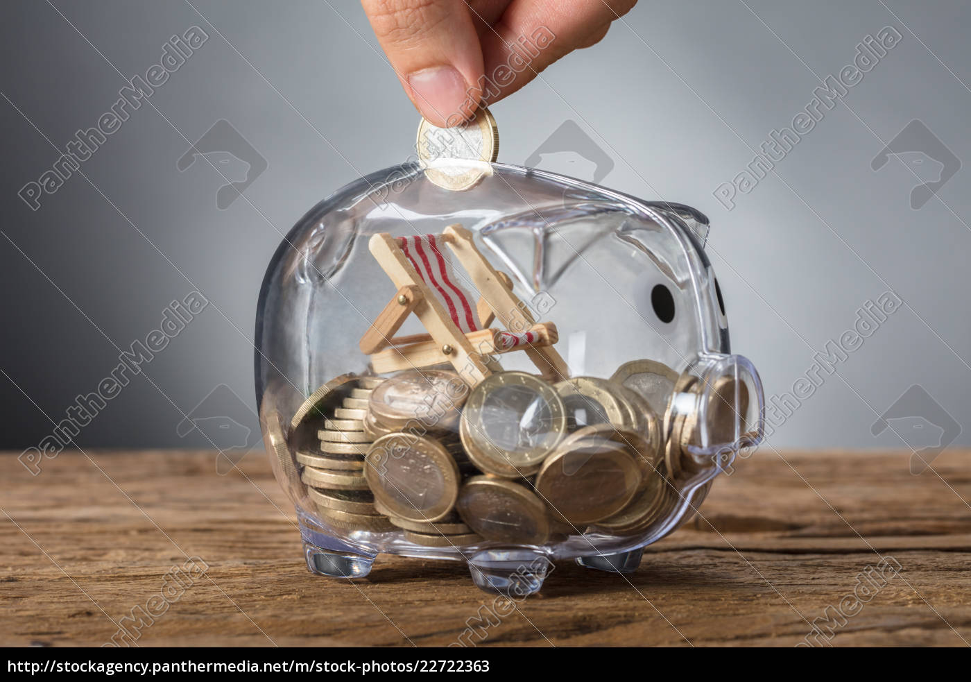 hand, putting, coin, in, transparent, piggy - 22722363