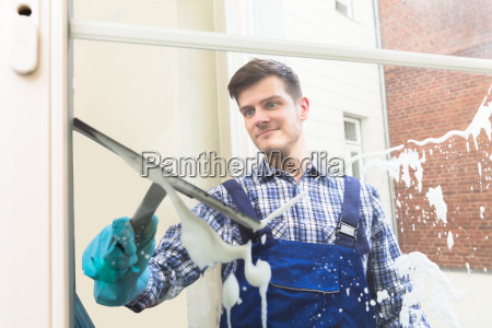 housekeeper, cleaning, window, with, squeegee - 22722949