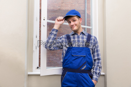 male, handyman, standing, near, window - 22722919