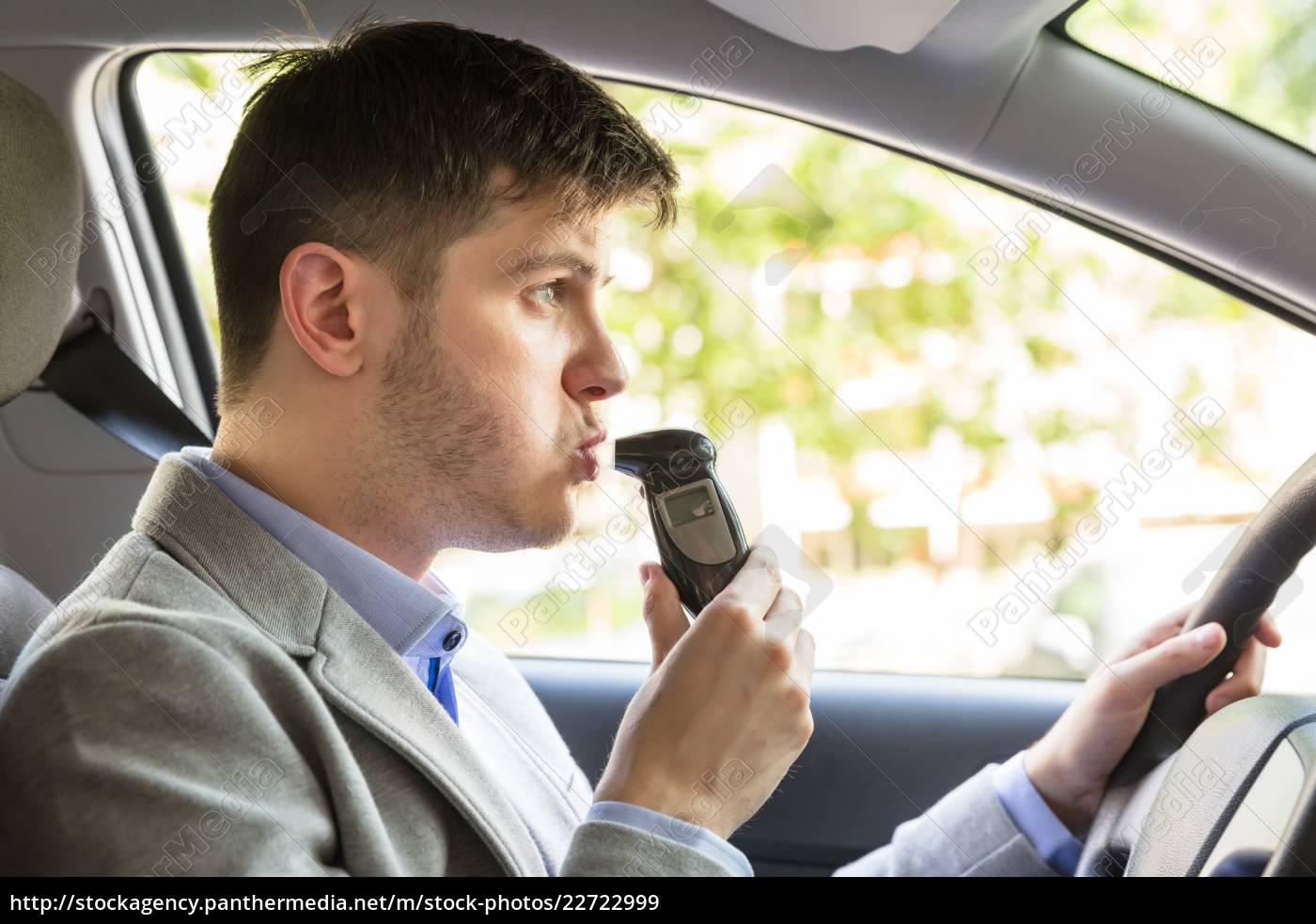 man, sitting, inside, car, taking, alcohol - 22722999