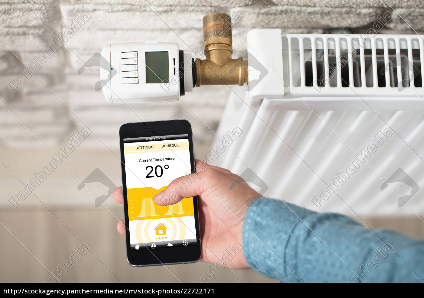 person, adjusting, temperature, of, radiator, on - 22722171