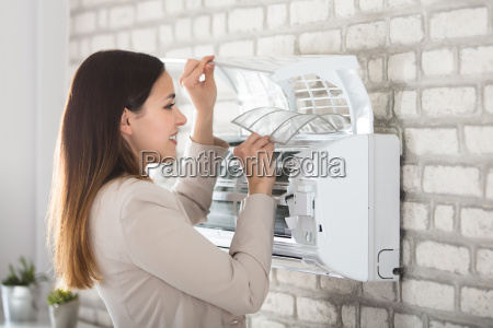 woman, cleaning, the, air, conditioner - 22722049