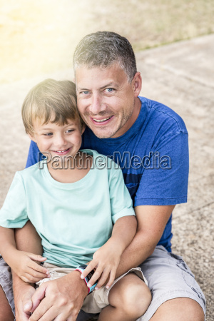 father and son cuddling on the