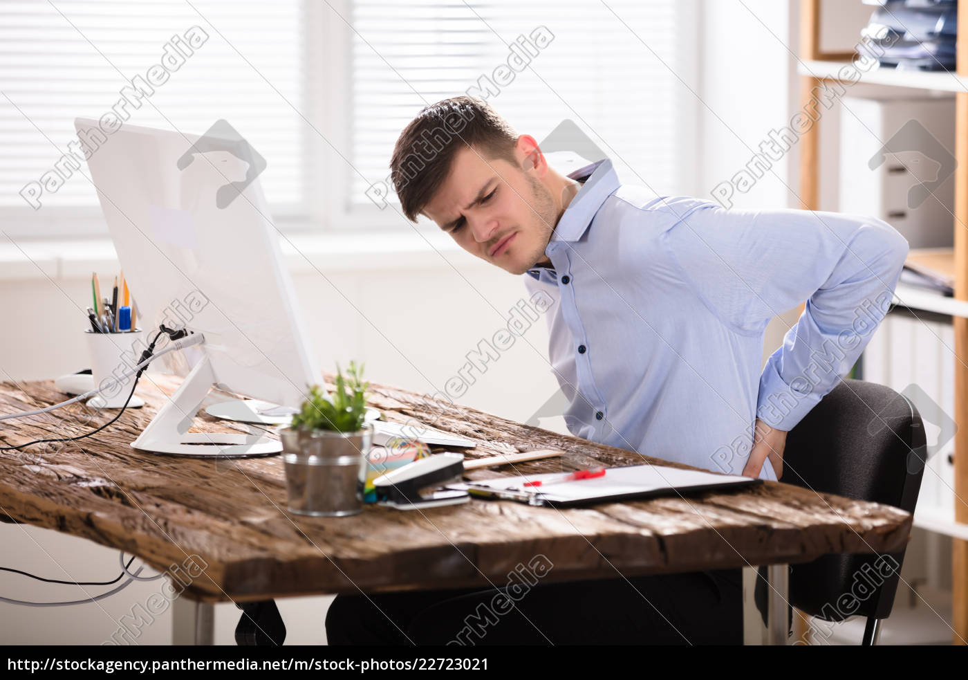 young, businessman, having, back, pain - 22723021