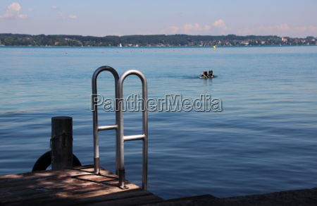 svimmers pier with steel ladder and