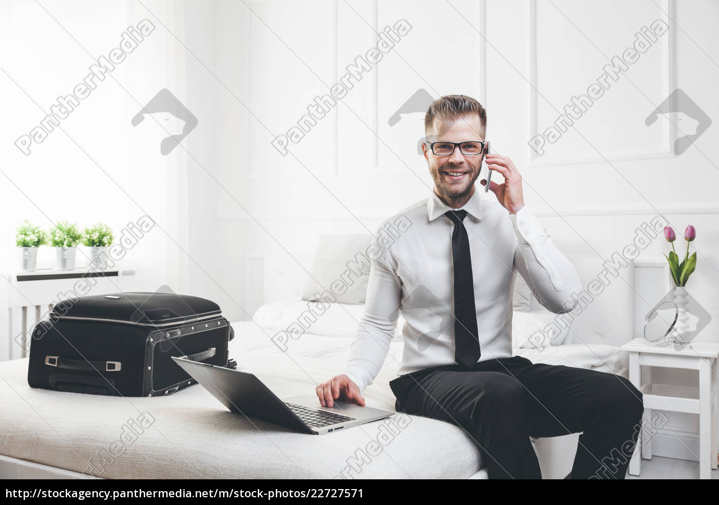 businessman, working, from, a, hotel, room - 22727571