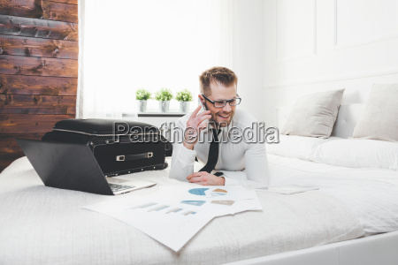 businessman, working, from, a, hotel, room - 22727597