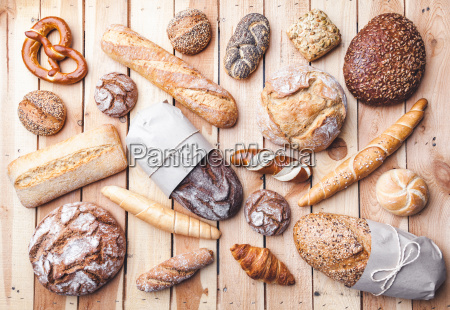 delicious, fresh, bread, on, wooden, background - 22727579